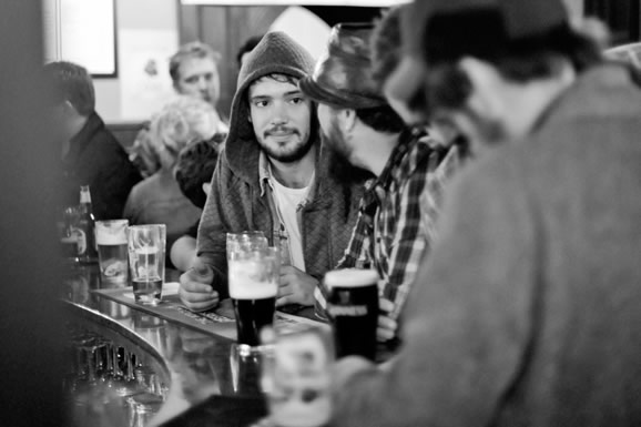 Ben Lovett enjoying a chin wag and Guiness. That's ther Life!